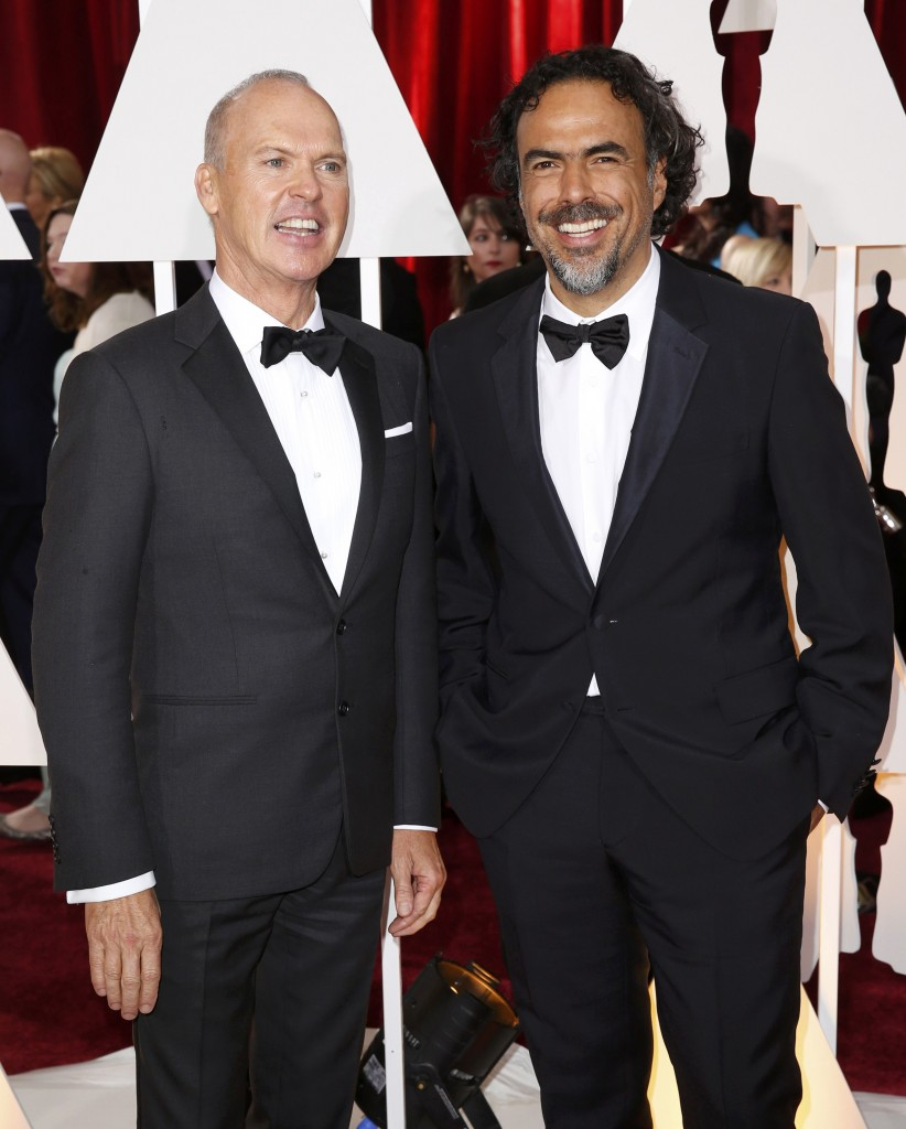 "Michael Keaton, nominated for Best Actor for the film ""Birdman"" and Inarritu, nominated for Best Director for the same film, arrive at the 87th Academy Awards in Hollywood"