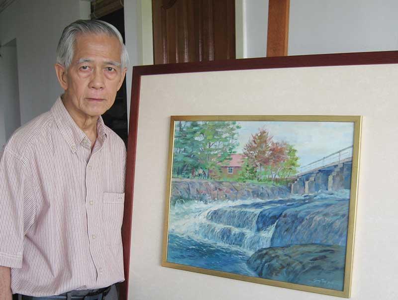 郑松川与他的风景作品。