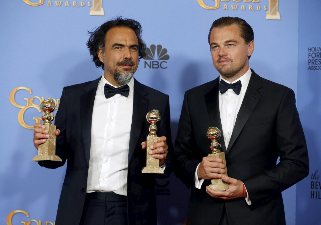 Alejandro Gonzalez Inarritu and Leonardo DiCaprio pose with their awards during the 73rd Golden Globe Awards in Beverly Hills