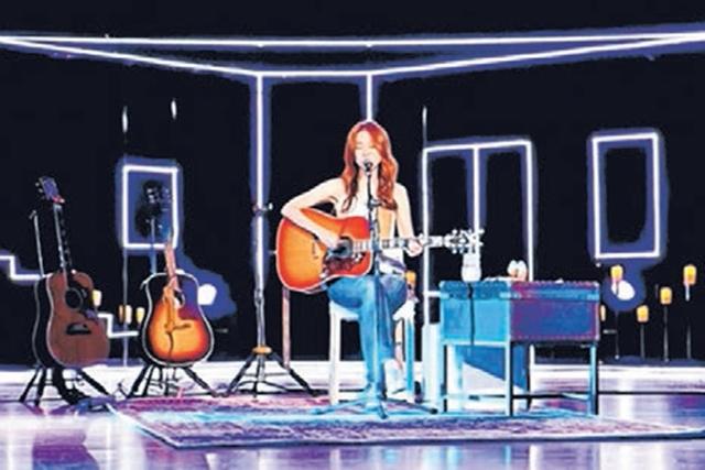 陈绮贞2本新书《瞬:陈绮贞歌词笔记》以及《吉他手的小动作》,浓缩了她出道18年的作品精华。(互联网)