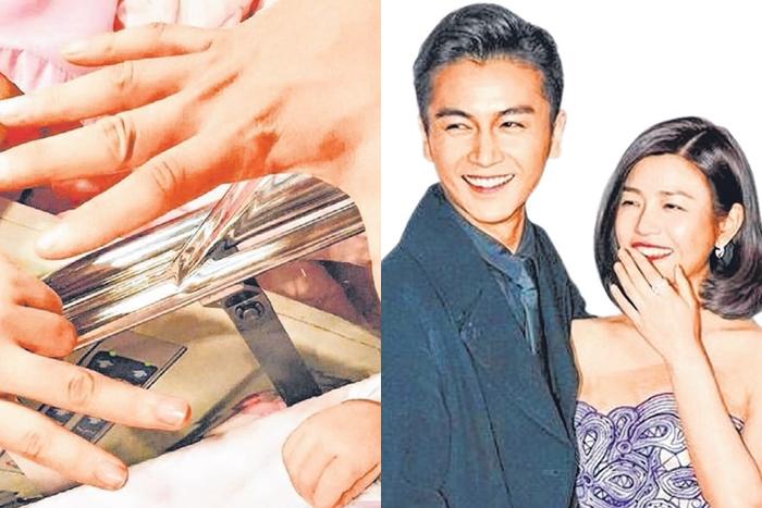 陈妍希和老公陈晓一起伸出手与儿子的小拳头合照。(互联网)